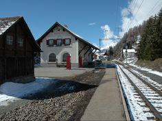 Train station of the Rhaetian Railway (RhB) in Madulain, Grisons, Switzerland.
