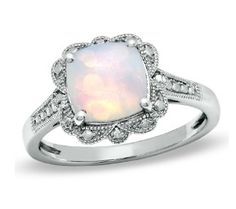 i wish opals were stronger. i would love to have a right hand every day opal ring like this