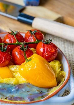 Omelette with cherry tomatoes, peppers and lavender cheese
