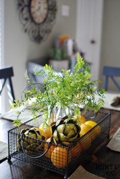 Wire basket with three vases with real or faux greens and a pop of yellow from the lemons. I love baskets, bowls and trays for centerpieces!Home Update Ideas – Part two Elegant Home Decor, Elegant Homes, Diy Home Decor, Wire Baskets, Beautiful Kitchens, Table Centerpieces, Home Renovation, Home Improvement, Sweet Home