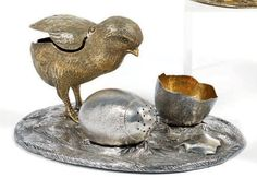 Salt and Pepper Shaker silver and vermeil. Represents a chick with a half egg shell and a movable egg which arises on the base of which small holes drilled end dislocates. The wings of the chick are mobile. The assembly rests on an herbaceous terrace. Silversmith Robert Hennell. London, 1871-1872.