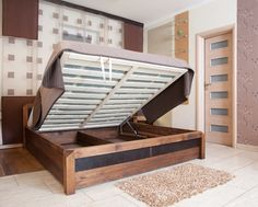 Tömörfa Ágykeret - Modena / Dió színben, vágott sarkokkal, gáztelelszkópos ágyneműtartóval