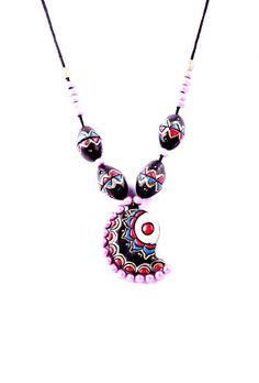 Multi-color Terracotta necklace set Dimension of necklace: 6 inches Dimension of earrings: 2.5 inches Weight: 58 gms Color: Multi-color Closure: Necklace: String, Earring: Metallic lock Material: Terracotta clay Finish: Hand-crafted Inspiration: Elements Of Nature
