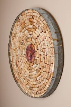 Stunning hand crafted bulleting board hand crafted using a reclaimed wine barrel band.   A recycled wine barrel band takes on a new form in this round bulletin board kit. Includes corks already glued on to make a 100% recycled bulleting board for your cellar or office.  Ideal for all wine lovers to don their cellars. For the ultimate collector, proudly displays the corks of finest bottles of wine. A functional and unique addition to kitchens, cellars, or offices.Each product is hand-crafted…