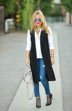 Long Vest. Ripped Jeans. Big Necklace www.thehuntercollector.com