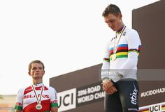 Silver medalist Vasil Kiryienka of Belarus and gold medalist Tony Martin of Germany stand on the podium during the medal ceremony for the Men's Elite Individual Time Trial on Day Four of the UCI Road World Championships at Lusail Sports Complex on October 12, 2016 in Doha, Qatar.