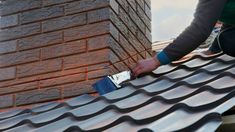 Roofer Builder Worker Attach Metal Sheet To The Chimney. Unfinished Roof Construction Stock Image - Image of install, installation: 109217711 Construction, Metal, Wordpress Theme, Image, Pipes, Tutorials, Tips, Building, Metals