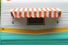 my little handmade awning.  Orange stripes with the yellow trim left over from the vinyl piping used for the cushions on the interior of our little vintage camper