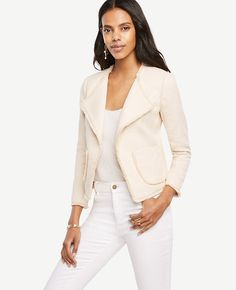"""Impeccably cut, our polished fringe jacket is a fine-tuned texture play. Long sleeves. Open front. Front patch pockets. Lined front and sleeves. 19"""" long."""