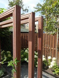 This style of arbor to train vine & block neighbors things we can see over the fence.