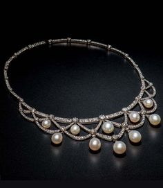 An antique pearl, and diamond necklace, European, c. 1880. Necklace with ten pearl drops each capped with small rose-cut diamonds. Two additional diamonds links. Necklace contains 289 old European and single-cut diamonds. They are arranged in a swag motif with the tear-dropped shaped pearls hanging as pendants. The removable pearls allow the necklace to be worn as an all diamond necklace. Formerly the property of Clarice de Rothschild #antique #necklace #Rothschild