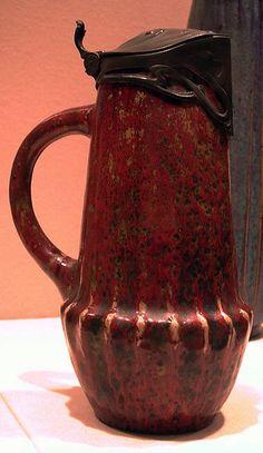 Adrien Pierre Dalpayrat ceramic flagon, pewter mounts attributed to Edward Colonna, 1898-1902, 10.25in. high.