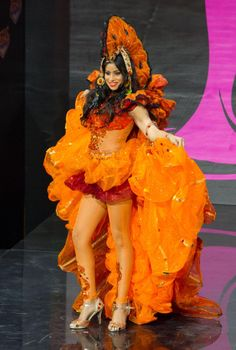 2013 MISS UNIVERSE NATIONAL COSTUME SHOW MISS GUYANA--KATHERIINA ROSHANA--ORANGE ALERT! THE LOVELY REPRESENTATIVE FOR HE CARIBBEAN NATION PARADED AROUND THE STAGE IN A SUPER RUFFLED ENSEMBLE.