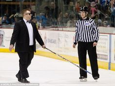 """We should talk more about the time the Wenatchee Wild's assistant Coach took a pair of sunglasses from the crowd and an upside down hockey stick and ran around the ice doing a """"Blind Ref"""" imitation after disagreeing with one of the officiating calls."""