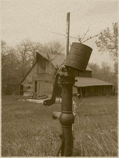 Old barn with the water pump