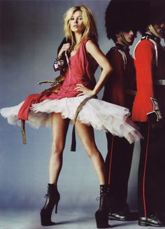 Kate Moss for McQueen- Royal Reds signature colours for Alexander McQueen. His work is also very much inspired by Britain and British values & culture- Hence the Queens Guards!