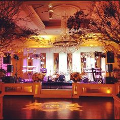 Love this mirrored stage facade and back wall we created. Events by Jackson Durham #jacksondurham