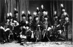 A group of Preobrazhensky regiment officers at 1903 ball - Romanov Anniversary Ball (1903)  A group of officers of the Life Guards Regiment (in outfits of people from the initial tenants times of Tsar Alexei Mikhailovich).  Officers: Colonel Nawrocki (third from right), Captain Korostovetz (second from right), Captain Mansurov, adjutant Captain Naryshkin, adjutant Captain Prince Obolensky (far right), Captain Svechin, Captain Drenteln (center), Lieutenant Baron Nolken Lieutenant Arseniev…