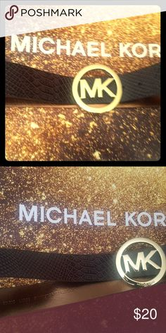 Michael Kors Women's Belt Michael Kors Women's Belt (unsure of authenticity, it was a gift) Size Large. Very stylish. Can be dressed up or down. Gold color on buckle is slightly faded in one area. Can fit a women's waist size 24-34 Michael Kors Accessories Belts