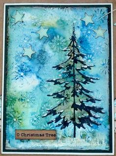 handmade Christmas card featuring a Tim Holtz Sizzix tree die on a watercolor background ... luv the variey of technques used in the background ...