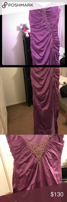 Perfect dress for special occasion Worn once . In great condition. About a size 4/6 . Paid over 250 for it. It's long with a slit up the leg to about the thigh . Dresses Prom