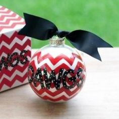 Any stylish fan will love this University of Georgia Chevron Ornament... Go Dawgs! Personalize it with a name and date for a special spirited keepsake. All collegiate ornaments come boxed and tied with a coordinating ribbon making them the perfect gift for anyone.