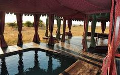 A tented oasis at Jack's Camp in the Makgadikgadi Pans, Botswana Quad Bike, Worlds Largest, Oasis, All Things, Pergola, National Parks, African, Outdoor Structures, Camping