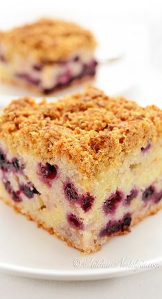 Blueberry Crumb Cake - light and moist yogurt cake with lemon flavor, full of fruit and topped with almond crumb topping. A dessert that can be served for breakfast! - kitchennostalgia.com