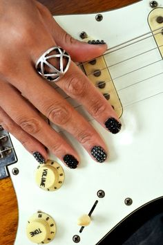 These Jem and the Holograms inspired nails will really get people noticing your guitar skills.