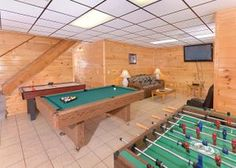 A game room in a Gatlinburg cabin with air hockey, foosball and billiards
