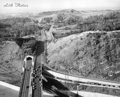 Aerial view of the California State Route 110/Arroyo Seco Parkway, the Figueroa Street Tunnels, and Elysian Park. Photograph dated February 20, 1958The Figueroa Street Tunnels are four art deco tunnels with subway-tile walls originally built between 1931 and 1935 on Figueroa Street in Elysian Park. In 1940 they were incorporated into California State Route 110/Arroyo Seco Parkway (Pasadena Freeway).