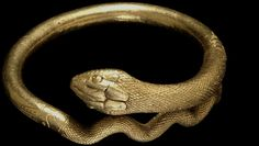 Gold bracelet in the form of a coiled snake found at Pompeii.  @Trustees of the British Museum