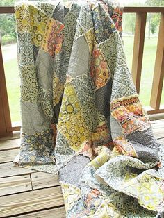 I am loving quilts, perhaps it is the cold air coming.  This quilt is beautiful off of etsy.  Handmade with love.