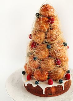 Lemon blueberry cake covered in lemon icing topped with a Croquembouche (with raspberry creme patissiere-filled choux pastry/profiteroles). Pretty Cakes, Beautiful Cakes, Delicious Desserts, Dessert Recipes, Berry Tart, Bastille Day, Choux Pastry, Cake Bars, French Pastries