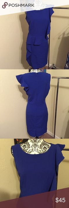 Calvin Klein sheath dress Beautiful blue Calvin Klein size 14 sheath dress with ruffle detail on the shoulder and hip. Excellent, like new condition. Dress measures approx 38in from top of shoulder to hem. Dress is 63% polyester, 33% rayon, 4% spandex. Lining is 100% polyester. Dry clean. Calvin Klein Dresses