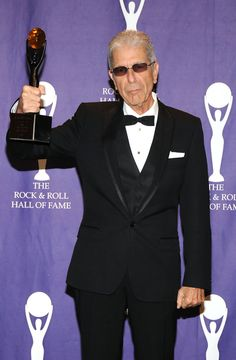 Leonard Cohen Photos Photos - Musician Leonard Cohen poses in the press room during the 2008 Rock & Roll Hall of Fame Induction ceremony at the Waldorf-Astoria Hotel March 10, 2008 in New York City. - 2008 Rock & Roll Hall Of Fame Induction - Press Room