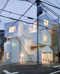Tokyo Apartments: Sou Fujimoto devised multi-unit housing by literally stacking house-shaped units one atop the other. The topmost units are accessed by exterior staircases, like vertical renditions the narrow alleyways one finds in Tokyo. Architecture Du Japon, Contemporary Architecture, Amazing Architecture, Architecture Design, Creative Architecture, Modern Contemporary, Sou Fujimoto, Exterior Stairs, Building Exterior