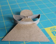 Recycled cardboard angel ornaments by 54mama, via Flickr