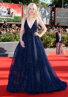 Dakota Johnson in a navy Elie Saab dress - click through to see more of the best Venice Film Festival fashion ever