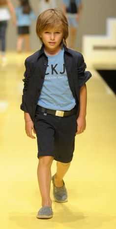 love the bermuda shorts trend.  My son is growing out of all his pants.  Just cut some slacks, add an interesting trim and belt and voila!