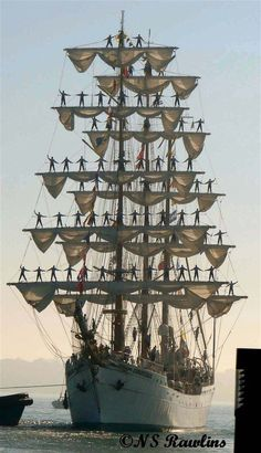 tall ship and sailors