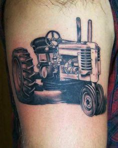 Tractor tattoo by Blake Gaudette at Crimson Heart Designs, Clear Lake, WI.  Awesome!!