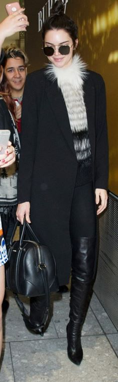 Who made  Kendall Jenner's black leather handbag, thigh high boots, and sunglasses?