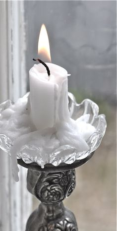Like this - diffused light and white-on-white, only color the candle flame.