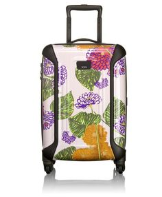 I walk by this store everyday and this caught my eye! Anna Sui Tumi luggage!