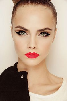 FIERCE cat eye makeup. Perfect bright red coral lipstick.
