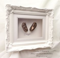Classical baroque swept frame style with baby feet in bronze. By Babyprints.co.uk