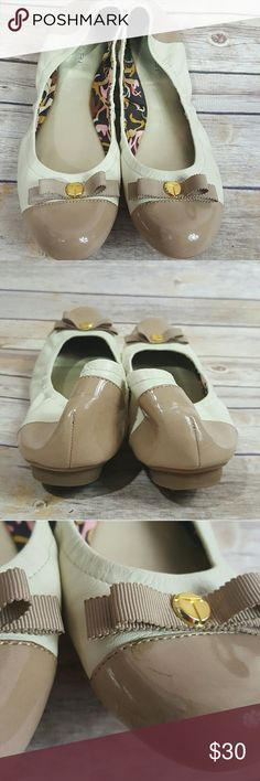 Tahari Gibson Leather Flats Taupe/beige and Ivory. Shiny toe and heel. Matching ribbon detail on toe with gold accent. A couple of minor marks as pictured. Gently worn. Tahari Shoes Flats & Loafers