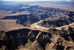 FISH RIVER CANYON (NAMIBIA) ::: this is the second largest canyon in the world and the largest in Africa, as well as the second most visited tourist attraction in Namibia. It features a gigantic ravine, in total about 100 miles (160 km) long, up to 27 km wide and in places almost 550 metres deep.
