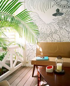 A wall mural in an outdoor sitting area at La Banane
